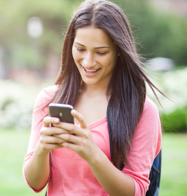 teen girl texting with smartphone